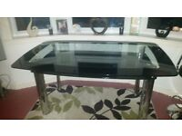 Glass dining table and bar stools
