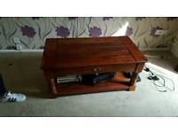 heavy dark wood large coffee table with 2 little draws