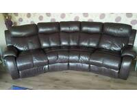 4 seater, brown, curved leather sofa with 2 ends reclining chairs.