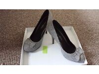 Ladies Black and white check shoes. Brand new in box. Fiore Size 7