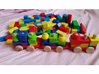 Toy wooden building brick and train