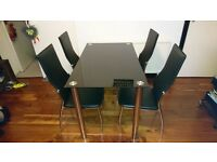 Black glass and chrome table and chairs
