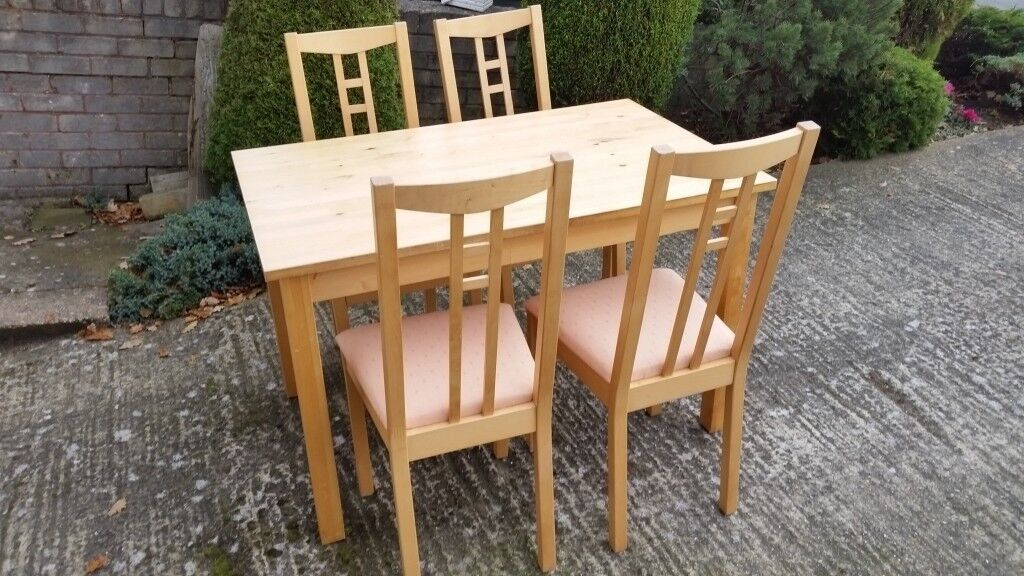 Kitchen Table and Four Chairs in light wood.