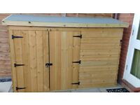 Newly assembled pressure treated wooden Bike Shed 7 ft x 2 ft