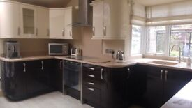 Avanti Cream and Wood Effect High Gloss Fitted Kitchen with Appliances and Corian Work Top