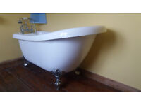 Roll top slipper bath, with taps and showerhead