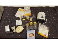 Medela swing breast pump bundle and bottle warmer