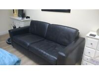 Leather sofa from Next. REDUCED. Very dark brown. Avaialbale immediately
