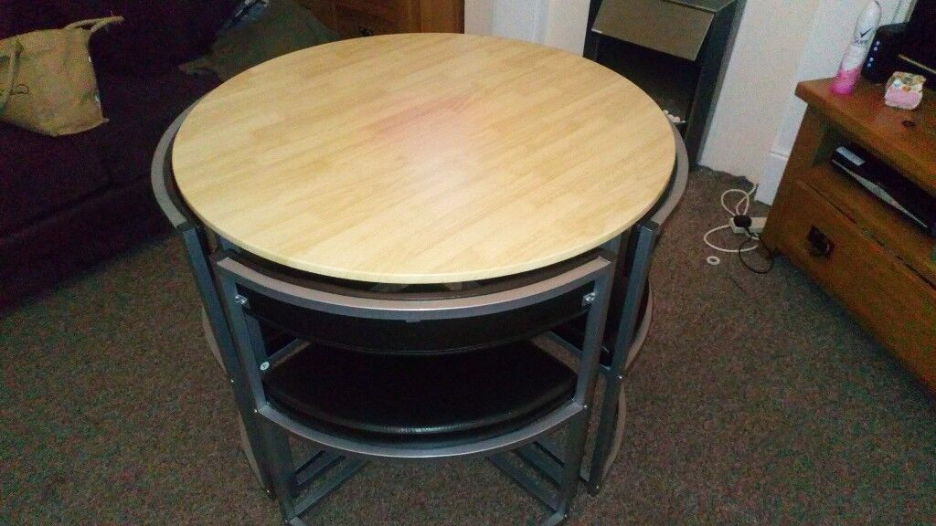 Table and 4 chairs excellent condition