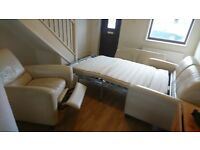 Faux leather sofa bed and reclining armchair - cream