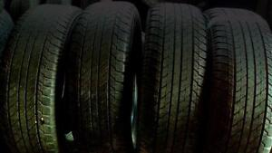 Four Yokahama P245 60 R20 M+S tires. and four 245 50 R20 M+S tires