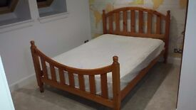 double bed wooden frame and mattress with protector