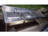 large double sink, single drainer.
