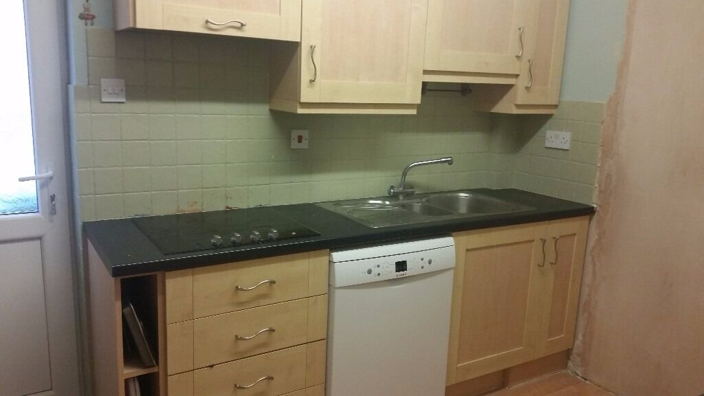 Full Hob Kitchen ~ Beech laminate kitchen units with black worktop