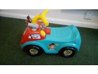 Child car bike (Unused) and teddy bear.