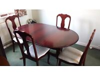 Mahogany finish extending Dining Table with 4 chairs