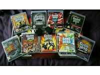 Ps3 Guitar hero guitar two adapters and 9 games