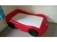 Little Tikes red single car bed with mattress