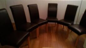 6 leather effect, dark brown, scrollback skirted dining chairs