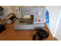 Singer heavy duty sewing machine for sale had for about a year its in excellent condition.