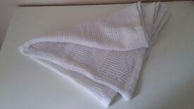 Unused knitted baby blanket