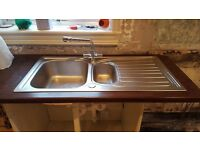 Gas hob, electric oven, extractor, microwave, sink and taps