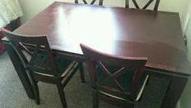 Fixed top oak veneered dining table and 4 chairs.