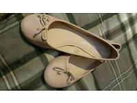 Nude pink ballet style pumps