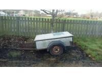 Small trailer with motor cross bike attachment.
