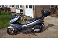 Silver Honda PCX 125 for sale - Low mileage - Excellent condition