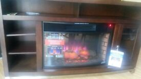 Lovely log effect electric fire in wooden surround