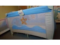 Dual level travel cot and mattress