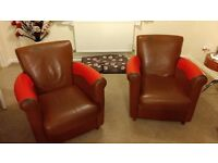 Two leather arm chairs