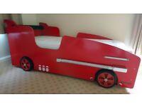 Ferrari tribute single bed. Sports wheels. LED lights. Padded spoiler/headboard. Excludes mattress.