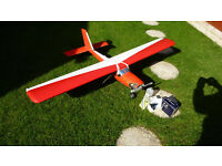Large model aircraft and glow plug engine, for radio control.