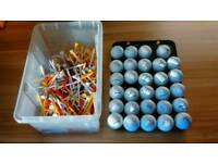 28 FIRST CLASS GOLF BALLS AND 100,s TEES