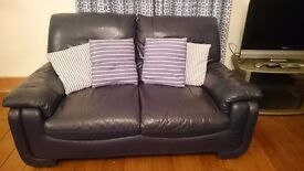 Three blue, leather sofas for sale. Will separate. (Price is for one x three seater)