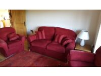 Red 2.5 seater sofa and two chairs.