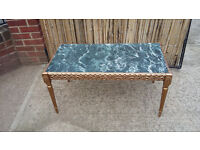 gold coloured coffee table with marble effect top