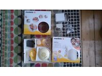 Medela Swing Electric Breast Pump - good used condition - plus extras