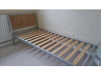Single bed - metal frame and timber headboard -