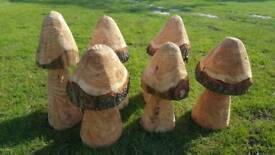 Carved wood mushrooms