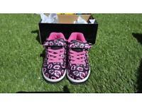 Pink and black heelies
