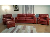 Ex-display Carolina red leather 3 seater, 2 armchairs and storage footstool