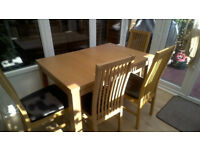 Extendable dining table + 4 chairs--REDUCED