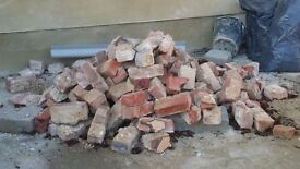 Free bricks, removed from chimney breast, must be collected.