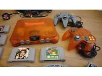 Nintendo 64 (N64) in great working condition + 2 controllers + 17 games + rumble pak