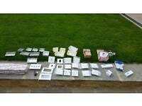 Assorted electrical fittings - lights, sockets, switches, faceplate etc