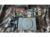 PlayStation with controllers and free games