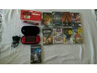Red PSP with case and charger plus games
